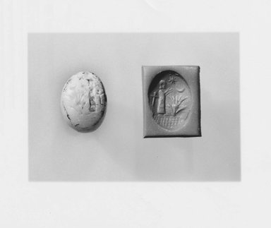 Ancient Near Eastern. <em>Stamp Seal: Worshipper Before Plant</em>, 6th-5th century B.C.E. Stone, 7/8 x 7/16 x 9/16 in. (2.2 x 1.1 x 1.4 cm). Brooklyn Museum, Designated Purchase Fund, 75.55.1. Creative Commons-BY (Photo: Brooklyn Museum, CUR.75.55.1_NegA_print_bw.jpg)