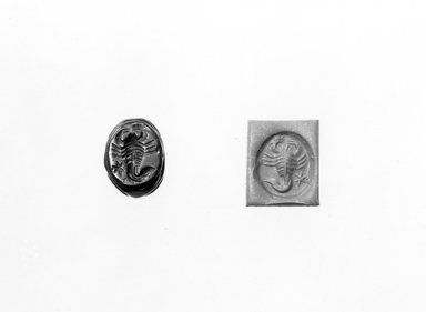 Ancient Near Eastern. <em>Stamp Seal: Scorpion with Star</em>, 3rd-7th century C.E. Hematite, 1/2 x 7/16 x 9/16 in. (1.3 x 1.2 x 1.4 cm). Brooklyn Museum, Designated Purchase Fund, 75.55.20. Creative Commons-BY (Photo: Brooklyn Museum, CUR.75.55.20_negA_bw.jpg)