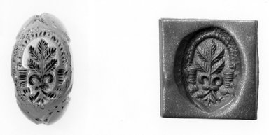 Ancient Near Eastern. <em>Stamp Seal: Plant with Five Leaves Surmounting Ribbons</em>, 3rd-7th century C.E. Quartz crystal, 11/16 x 7/16 x 9/16 in. (1.8 x 1.2 x 1.5 cm). Brooklyn Museum, Designated Purchase Fund, 75.55.23. Creative Commons-BY (Photo: Brooklyn Museum, CUR.75.55.23_negA_bw.jpg)