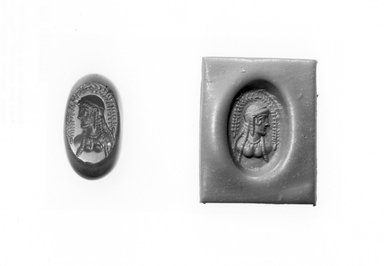 Ancient Near Eastern. <em>Stamp Seal: Female Bust</em>, 3rd-7th century C.E. Chalcedony, 11/16 x 7/16 x 11/16 in. (1.8 x 1.1 x 1.7 cm). Brooklyn Museum, Designated Purchase Fund, 75.55.2. Creative Commons-BY (Photo: Brooklyn Museum, CUR.75.55.2_negA_bw.jpg)