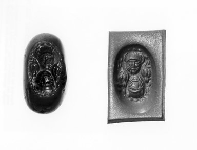 Ancient Near Eastern. <em>Stamp Seal: Two Human Heads</em>, 3rd-7th century C.E. Chalcedony, 3/4 x 3/8 x 5/8 in. (1.9 x 1 x 1.6 cm). Brooklyn Museum, Designated Purchase Fund, 75.55.3. Creative Commons-BY (Photo: Brooklyn Museum, CUR.75.55.3_negA_bw.jpg)