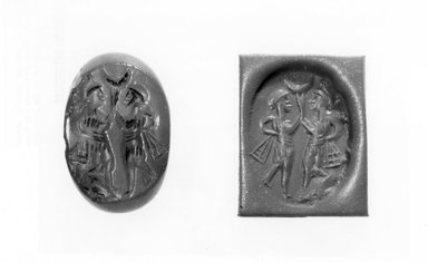Ancient Near Eastern. <em>Stamp Seal: Two Dancers with Ribbons, Crescent</em>, 3rd-7th century C.E. (possibly). Chalcedony, Accession Cards: Measurements:. Brooklyn Museum, Designated Purchase Fund, 75.55.5. Creative Commons-BY (Photo: Brooklyn Museum, CUR.75.55.5_negA_bw.jpg)