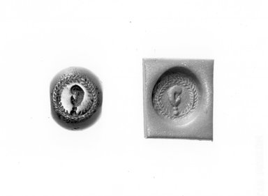 Ancient Near Eastern. <em>Stamp Seal: Ear with Earring</em>, 3rd-7th century C.E. Chalcedony, 7/16 x Diam. 5/16 in. (1 x 0.9 cm). Brooklyn Museum, Designated Purchase Fund, 75.55.7. Creative Commons-BY (Photo: Brooklyn Museum, CUR.75.55.7_negA_bw.jpg)