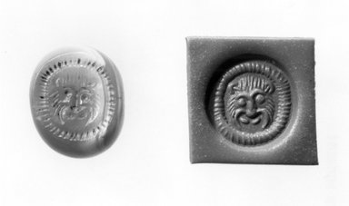 Ancient Near Eastern. <em>Stamp Seal: Lion Head</em>, 3rd-7th century C.E. Chalcedony, 1/2 x 1/2 x 11/16 in. (1.3 x 1.2 x 1.7 cm). Brooklyn Museum, Designated Purchase Fund, 75.55.8. Creative Commons-BY (Photo: Brooklyn Museum, CUR.75.55.8_negA_bw.jpg)