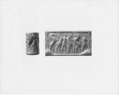 Ancient Near Eastern. <em>Cylinder Seal</em>, 2500 B.C.E. Marble, 1 1/4 x Diam. 3/4 in. (3.2 x 2 cm). Brooklyn Museum, Hagop Kevorkian Fund, 76.107. Creative Commons-BY (Photo: Brooklyn Museum, CUR.76.107_NegA_print_bw.jpg)