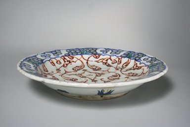 <em>Plate</em>, 17th century. Ceramic, 2 1/16 x 11 3/4 in. (5.3 x 29.8 cm). Brooklyn Museum, Gift of Dr. Charles S. Grippi, 76.172. Creative Commons-BY (Photo: Brooklyn Museum, CUR.76.172_exterior.jpg)