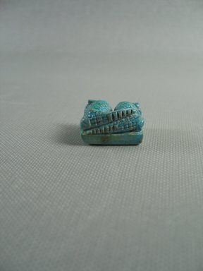 <em>Amulet</em>, 664-343 B.C.E. Faience, 9/16 x 11/16 x 7/8 in. (1.4 x 1.7 x 2.3 cm). Brooklyn Museum, Gift of Peter Sharrer, 76.37. Creative Commons-BY (Photo: Brooklyn Museum, CUR.76.37_View2.jpg)