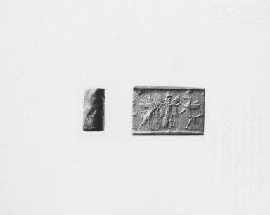 Ancient Near Eastern. <em>Cylinder Seal</em>, late 8th-7th century B.C.E. Lapis Lazuli, 1 1/4 x 5/8 in. (3.3 x 1.7 cm). Brooklyn Museum, Hagop Kevorkian Fund, 76.41.1. Creative Commons-BY (Photo: Brooklyn Museum, CUR.76.41.1_NegA_print_bw.jpg)