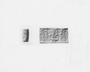 Ancient Near Eastern. <em>Cylinder Seal</em>, early 2nd millennium B.C.E. Marble, 11/16 x Diam. 3/8 in. (1.7 x 0.9 cm). Brooklyn Museum, Hagop Kevorkian Fund, 76.41.2. Creative Commons-BY (Photo: Brooklyn Museum, CUR.76.41.2_NegA_print_bw.jpg)
