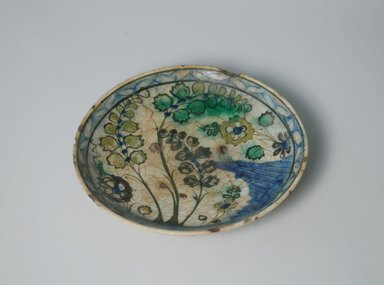 <em>Plate</em>, 17th century. Ceramic, Kubachi ware; fritware, painted in olive green, cobalt blue and green with yellow slip under a transparent glaze, 1 3/4 x 7 9/16 in. (4.5 x 19.2 cm). Brooklyn Museum, Gift of Ernest Erickson, 76.9. Creative Commons-BY (Photo: Brooklyn Museum, CUR.76.9.jpg)