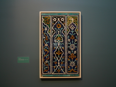 <em>Panel of 16 Tiles from the Shrine of Zayn al-Mulk</em>, A.H. 885/1480-81 C.E. Ceramic; fritware, painted in cobalt blue, turquoise, green, manganese purple, yellow ochre, and opaque white glazes, cut to shape in the mosaic faience technique and set in plaster, frame: 41 x 28 in. (104.1 x 71.1 cm). Brooklyn Museum, Gift of Evelyn Metzger, 77.196.3. Creative Commons-BY (Photo: Brooklyn Museum, CUR.77.196.3.jpg)