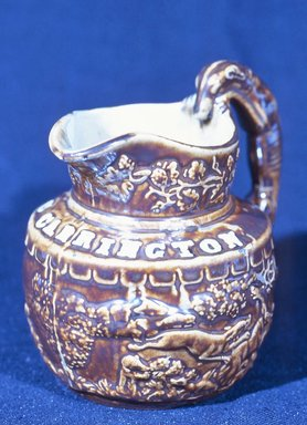 Salamandre Works. <em>Pitcher</em>, ca. 1845. Rockingham-glazed earthenware, 5 x 3 3/8 in. (12.7 x 8.6 cm). Brooklyn Museum, Gift of Allison C. Paulsen in memory of Arthur W. Clement, 77.45.4. Creative Commons-BY (Photo: Brooklyn Museum, CUR.77.45.4.jpg)