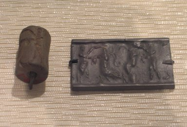 Ancient Near Eastern. <em>Cylinder Seal: Combat Scene</em>, ca. 2255-2154 B.C.E. Serpentine, 1 3/16 x Diam. 3/4 in. (3 x 1.9 cm). Brooklyn Museum, Special Hagop Kevorkian Grant Fund, 77.52.1. Creative Commons-BY (Photo: Brooklyn Museum, CUR.77.52.1_kevorkian_03_09.jpg)