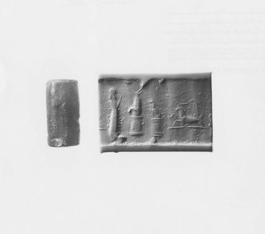 Ancient Near Eastern. <em>Cylinder Seal</em>, 625-400 B.C.E. Chalcedony, 1 1/16 x Diam. 9/16 in. (2.7 x 1.4 cm). Brooklyn Museum, Special Hagop Kevorkian Grant Fund, 77.52.3. Creative Commons-BY (Photo: Brooklyn Museum, CUR.77.52.3_NegA_print_bw.jpg)