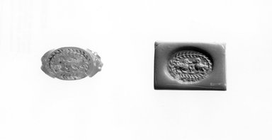 Ancient Near Eastern. <em>Stamp Seal</em>, 3rd-7th century C.E. Carnelian, 1/2 x 3/8 x 9/16 in. (1.3 x 1 x 1.4 cm). Brooklyn Museum, Special Middle Eastern Art Fund, 77.8.1. Creative Commons-BY (Photo: Brooklyn Museum, CUR.77.8.1_negA_bw.jpg)