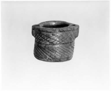 Parthian. <em>Cylindrical Pot</em>, 3rd century B.C.E.-7th century C.E. Clay, 1 7/16 × 2 1/16 in. (3.7 × 5.2 cm). Brooklyn Museum, Gift of Henry Anavian, 77.88. Creative Commons-BY (Photo: Brooklyn Museum, CUR.77.88_negA_bw.jpg)