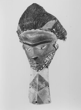 Pende (Western). <em>Mask (Mbuya) with Long Beard (Kiwoyo-Muyombo)</em>, 19th or 20th century. Wood, pigment, raffia, fiber, 16 x 7 1/2 x 14 1/4 in. (40.6 x 19.0 x 36.3 cm). Brooklyn Museum, Gift of Mr. and Mrs. J. Gordon Douglas III, 78.115.3. Creative Commons-BY (Photo: Brooklyn Museum, CUR.78.115.3_print_threequarter_bw.jpg)