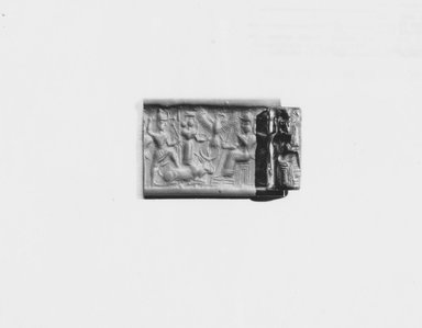Ancient Near Eastern. <em>Cylinder Seal</em>, 1450-1300 B.C.E. Hematite, 15/16 x Diam. 7/16 in. (2.4 x 1.1 cm). Brooklyn Museum, Special Middle Eastern Art Fund, 78.133. Creative Commons-BY (Photo: Brooklyn Museum, CUR.78.133_NegA_print_bw.jpg)