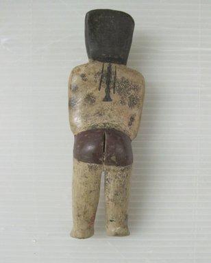 Nazca. <em>Figurine</em>, circa 650 C.E. Ceramic, polychrome slip, 7 1/16 × 2 1/4 × 1 5/16 in. (17.9 × 5.7 × 3.3 cm). Brooklyn Museum, Gift of Cynthia Hazen Polsky, 79.116.1. Creative Commons-BY (Photo: Brooklyn Museum, CUR.79.116.1_view02.jpg)