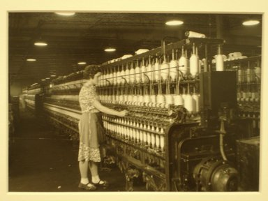 Lewis Wickes Hine (American, 1874-1940). <em>[Untitled] (Woman at Thread Bobbin)</em>, 1936-1937. Gelatin silver photograph, 4 3/4 x 7 1/4 in.  (12.1 x 18.4 cm). Brooklyn Museum, Gift of the National Archives, 79.143.127 (Photo: Brooklyn Museum, CUR.79.143.127.jpg)