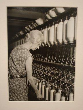 Lewis Wickes Hine (American, 1874-1940). <em>[Untitled] (Elderly Woman at Bank of Thread Cylinders)</em>, 1936-1937. Gelatin silver photograph, 7 1/4 x 4 3/4 in. (18.4 x 12.1 cm). Brooklyn Museum, Gift of the National Archives, 79.143.130 (Photo: Brooklyn Museum, CUR.79.143.130.jpg)