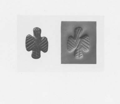 Ancient Near Eastern. <em>Stamp Seal in the Shape of a Spread - Winged Bird</em>, ca. 3500 B.C.E. Stone, 5/8 x 7/8 in. (1.6 x 2.2 cm). Brooklyn Museum, Gift of David Liebert, 79.32. Creative Commons-BY (Photo: Brooklyn Museum, CUR.79.32_NegA_print_bw.jpg)