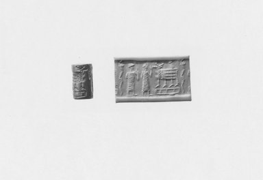 Ancient Near Eastern. <em>Cylinder Seal</em>, 2000-1700 B.C.E. Hematite (?), 11/16 x Diam. 7/16 in. (1.7 x 1 cm). Brooklyn Museum, Gift of Mr. and Mrs. Carl L. Selden, 80.173.1. Creative Commons-BY (Photo: Brooklyn Museum, CUR.80.173.1_NegA_print_bw.jpg)