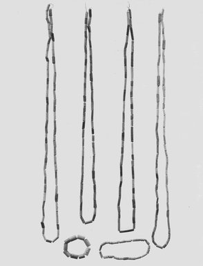 <em>Six Groups of Tubular Beads</em>, ca. 1075-656 B.C.E. Faience, Approx. diam. of each bead: 0.1 cm. Brooklyn Museum, Gift of the Egyptian Antiquities Organization, 80.7.22. Creative Commons-BY (Photo: Brooklyn Museum, CUR.80.7.22_NegA_print_bw.jpg)