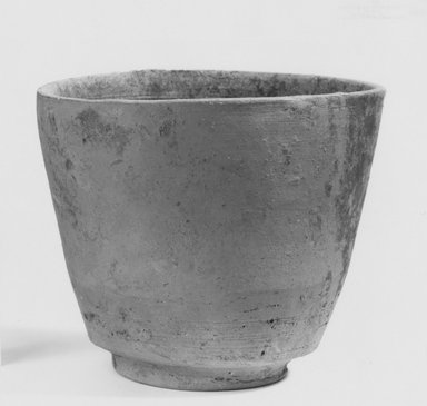 <em>Beaker</em>, 305-30 B.C.E. Clay, 3 5/8 x 4 5/16 in. (9.2 x 11 cm). Brooklyn Museum, Gift of the Egyptian Antiquities Organization, 80.7.25. Creative Commons-BY (Photo: Brooklyn Museum, CUR.80.7.25_NegA_print_bw.jpg)