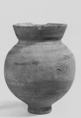<em>Vase</em>, 305-30 B.C.E. Clay, slip, 4 5/16 x 3 7/16 in. (11 x 8.8 cm). Brooklyn Museum, Gift of the Egyptian Antiquities Organization, 80.7.9. Creative Commons-BY (Photo: Brooklyn Museum, CUR.80.7.9_NegA_print_bw.jpg)