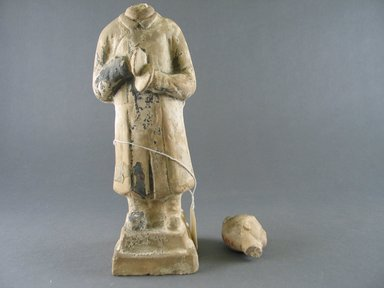 <em>Tomb Figure of a Cymbal Player</em>, 8th-9th century. Pottery, 10 1/4 x 3 in. (26 x 7.6 cm). Brooklyn Museum, Gift of Lucile E. Selz, 81.125.5. Creative Commons-BY (Photo: Brooklyn Museum, CUR.81.125.5_front.jpg)