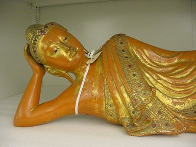 <em>Reclining Buddha</em>, 19th century. Gilt wood, 12 1/2 x 44 in. (31.8 x 111.8 cm). Brooklyn Museum, Gift of Leon Amar, 81.202.1. Creative Commons-BY (Photo: Brooklyn Museum, CUR.81.202.1_detail1.jpg)