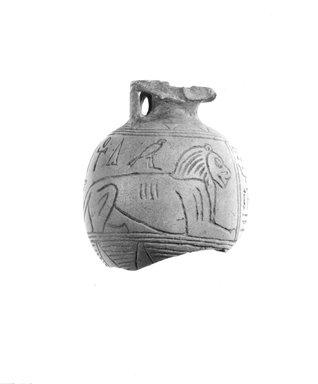 <em>Aryballos</em>, 7th-6th century B.C.E. Faience, 2 11/16 x 7 1/2 in. (6.8 x 19 cm); rim: 1 1/4 in. (3.2 cm). Brooklyn Museum, Gift of Peter Sharrer, 81.313. Creative Commons-BY (Photo: Brooklyn Museum, CUR.81.313_NegA_print_bw.jpg)
