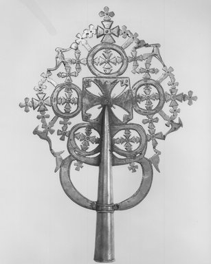 Amhara. <em>Processional Cross (qäqwami mäsqäl)</em>, 19th century. Copper alloy, 15 5/8 x 10 7/8 in.  (39.7 x 27.7 cm). Brooklyn Museum, Gift of George V. Corinaldi Jr., 82.102.1. Creative Commons-BY (Photo: Brooklyn Museum, CUR.82.102.1_print_bw.jpg)