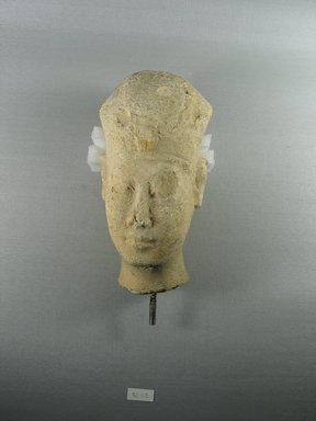 <em>Head of a King</em>, ca. 300-200 B.C.E. Limestone, 7 3/8 x 3 3/4 x 3 7/8 in. (18.8 x 9.5 x 9.8 cm). Brooklyn Museum, Gift of Beatrice Kelekian in memory of Charles D. Kelekian and in honor of Bernard V. Bothmer, 82.115. Creative Commons-BY (Photo: Brooklyn Museum, CUR.82.115_view1.jpg)