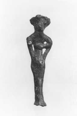 Syro-Lebanese. <em>Standing Male Figure with 4 Arms</em>, 2000-1500 B.C.E. Bronze, 2 13/16 x 13/16 in. (7.1 x 2.1 cm). Brooklyn Museum, Gift of Jonathan P. Rosen, 82.116.5. Creative Commons-BY (Photo: Brooklyn Museum, CUR.82.116.5_negA_bw.jpg)