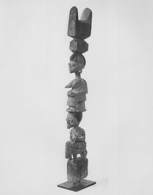 Yorùbá. <em>Housepost, One of Pair</em>, late 19th or early 20th century. Wood, pigment, 64 x 9 1/4 x 6 in. (162.6 x 23.5 x 15.2 cm). Brooklyn Museum, Gift of Allen A. Davis, 82.154.1. Creative Commons-BY (Photo: Brooklyn Museum, CUR.82.154.1_print_bw.jpg)