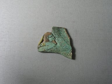 Egyptian. <em>Fragment of Cosmetic Spoon</em>, ca. 1400-1300 B.C.E. Faience, 1 7/8 × 1 3/4 × 1/4 in. (4.7 × 4.4 × 0.6 cm). Brooklyn Museum, Gift of Peter Sharrer, 82.170.1. Creative Commons-BY (Photo: , CUR.82.170.1_view01.jpg)