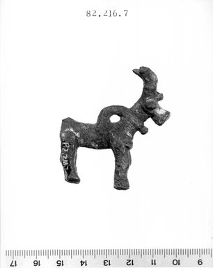<em>Statuette of Goat</em>, ca. 1100-600 B.C.E. Bronze, 2 1/8 x 1 7/8 in. (5.4 x 4.7 cm). Brooklyn Museum, Gift of Ben B. Shepps, 82.216.7. Creative Commons-BY (Photo: Brooklyn Museum, CUR.82.216.7_NegA_print_bw.jpg)