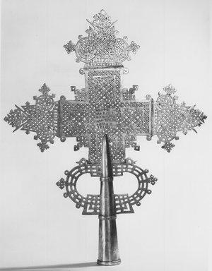 Amhara. <em>Processional Cross (qäqwami mäsqäl)</em>, 20th century. Silver, 19 1/8 x 15 1/16 in. (48.6 x 38.8 cm). Brooklyn Museum, Gift of George V. Corinaldi, Jr., 83.144. Creative Commons-BY (Photo: Brooklyn Museum, CUR.83.144_print_bw.jpg)