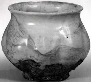 <em>Jar</em>, early 12th century. Ding ware, buff stoneware, 3 3/4 x 4 1/2 in. (9.5 x 11.4 cm). Brooklyn Museum, Gift of Dr. and Mrs. John P. Lyden, 83.168.7. Creative Commons-BY (Photo: Brooklyn Museum, CUR.83.168.7_bw.jpg)
