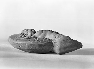 Roman. <em>Lamp Handle</em>, 2nd century C.E. Terracotta, 4 5/8 x 3 1/8 x 1 1/2 in. (11.8 x 8 x 3.8 cm). Brooklyn Museum, Gift of Mr. and Mrs. David A. J. Liebert, 84.130. Creative Commons-BY (Photo: Brooklyn Museum, CUR.84.130_negA_bw.jpg)