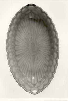 <em>Arita Celadon Side Dish</em>, 18th century. White porcelain, 2 1/8 x 8 3/4 in. (5.4 x 22.2 cm). Brooklyn Museum, Gift of Dr. and Mrs. Malcolm Idelson, 84.190.5. Creative Commons-BY (Photo: Brooklyn Museum, CUR.84.190.5_bw.jpg)