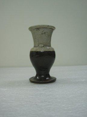 <em>Seto Ware Vase</em>, 19th century. Buff stoneware, 5 x 2 3/4 in. (12.7 x 7 cm). Brooklyn Museum, Gift of Dr. Kenneth Rosenbaum, 84.203.14. Creative Commons-BY (Photo: Brooklyn Museum, CUR.84.203.14_side.jpg)