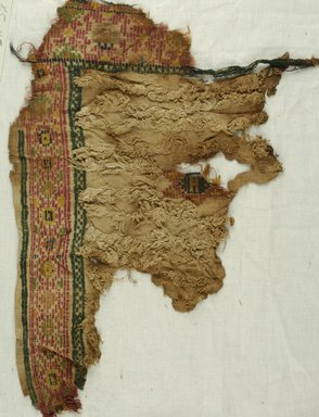 Coptic. <em>Fragment with Botanical and Geometric Decoration</em>, 8th century C.E. Wool, 11 1/2 x 18 in. (29.2 x 45.7 cm). Brooklyn Museum, Gift of Philip Gould, 85.165.4. Creative Commons-BY (Photo: Brooklyn Museum (in collaboration with Index of Christian Art, Princeton University), CUR.85.165.4_ICA.jpg)
