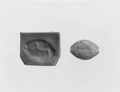 Late Minoan III. <em>Magic Gem</em>, 7th-6th century B.C.E. Green jasper, 5/8 x 11/16 in. (1.6 x 1.8 cm). Brooklyn Museum, Gift of Furman C. Hebb, 85.214.1. Creative Commons-BY (Photo: Brooklyn Museum, CUR.85.214.1_NegA_print_bw.jpg)