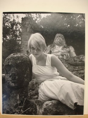 Philippe Halsman (American, born Latvia, 1906-1979). <em>Swedish Model (Blonde Woman in White Dress Leaning Against Statue of a Head)</em>. Gelatin silver photograph Brooklyn Museum, Gift of Dr. and Mrs. Arthur E. Kahn, 85.294.6. © artist or artist's estate (Photo: Brooklyn Museum, CUR.85.294.6.jpg)