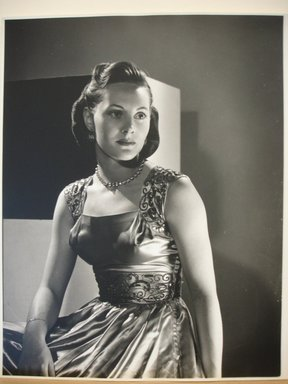 Philippe Halsman (American, born Latvia, 1906-1979). <em>[Untitled] (Brunette Woman Looking to Right, Wearing Dress with Sequined Straps and Waist)</em>. Gelatin silver photograph Brooklyn Museum, Gift of Dr. and Mrs. Arthur E. Kahn, 85.294.8. © artist or artist's estate (Photo: Brooklyn Museum, CUR.85.294.8.jpg)