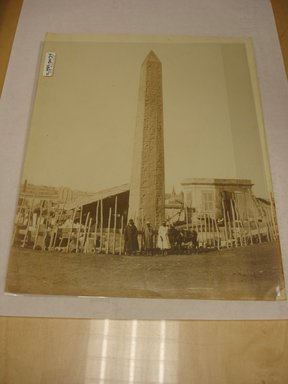 Wihelm Hammerschmidt (German, died 1869). <em>Obelisk in Alexandria (with Egyptian Men Standing at Base)</em>, mid-19th century. Albumen silver photograph, image/sheet: 7 3/4 x 10 1/4 in. (19.7 x 26 cm). Brooklyn Museum, Gift of Matthew Dontzin, 85.305.34 (Photo: Brooklyn Museum, CUR.85.305.34.jpg)