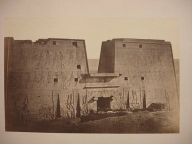 Wihelm Hammerschmidt (German, died 1869). <em>Temple of Horus Pylon, Edfu</em>, mid-19th century. Albumen silver photograph, image/sheet: 7 3/4 x 10 1/4 in. (19.7 x 26 cm). Brooklyn Museum, Gift of Matthew Dontzin, 85.305.41 (Photo: Brooklyn Museum, CUR.85.305.41.jpg)